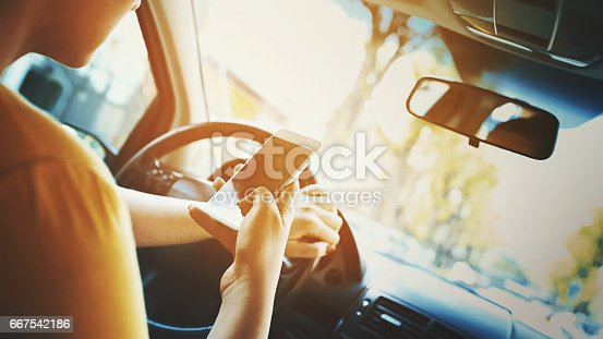 istock Texting and driving. 667542186