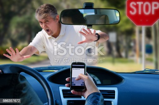 istock Texting and driving wreck hitting pedestrian 586357672