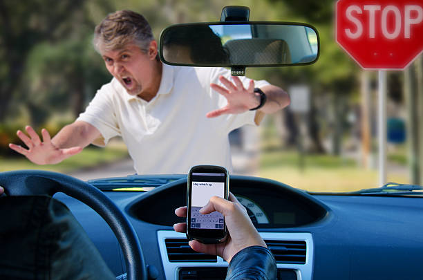 texting and driving wreck hitting pedestrian - text messaging stock photos and pictures