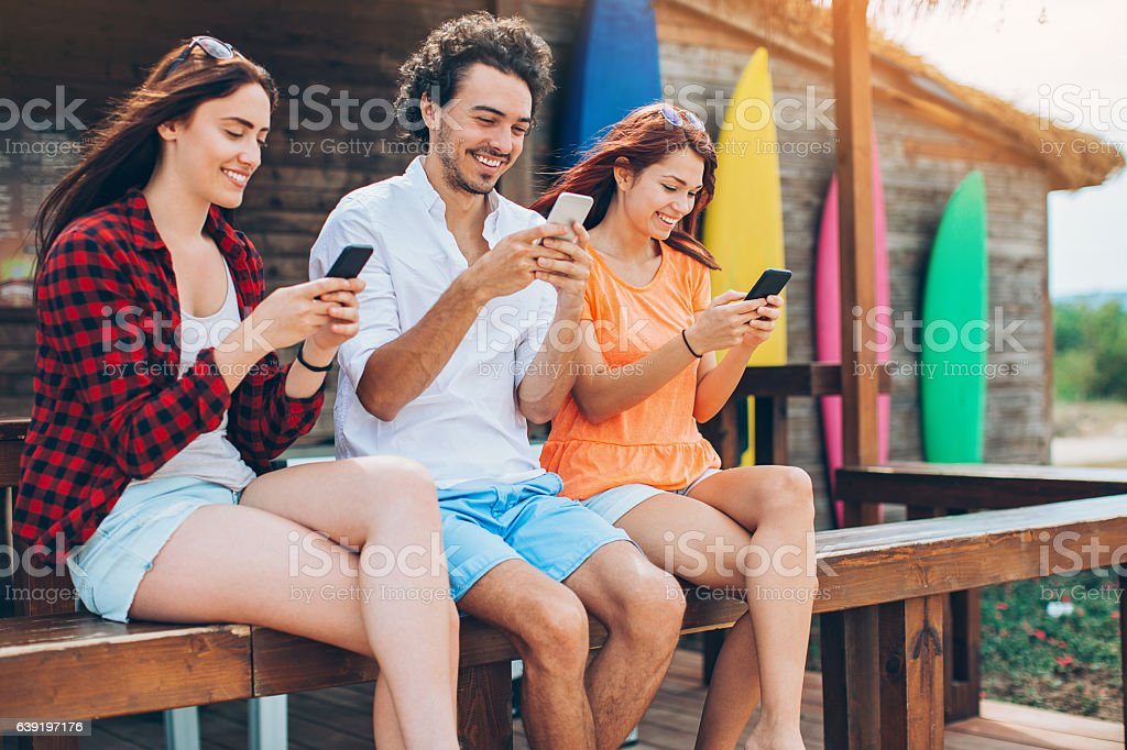 Texting and surfing stock photo