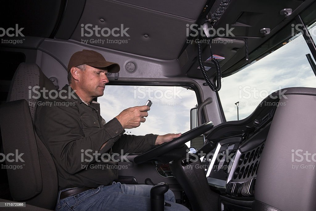 Texting and trucking stock photo