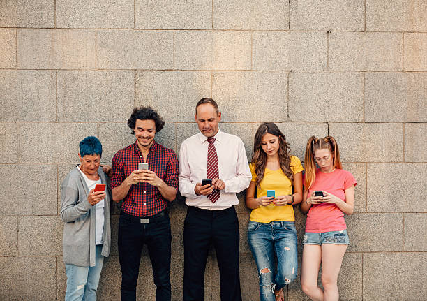 Texting at different ages Five people at different ages texting seperately. age contrast stock pictures, royalty-free photos & images