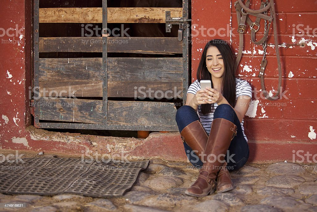 Texting at the stables stock photo