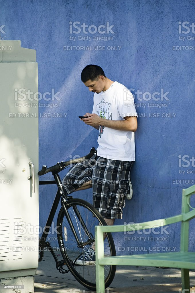 texting, blue wall stock photo
