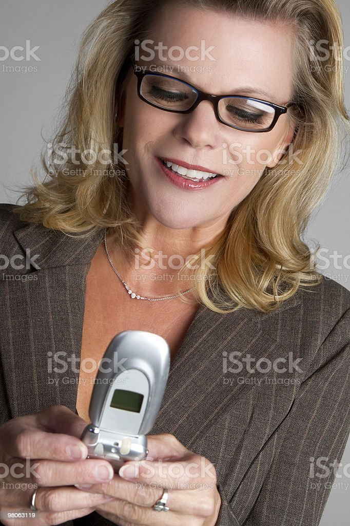 Texting Businesswoman royalty-free stock photo