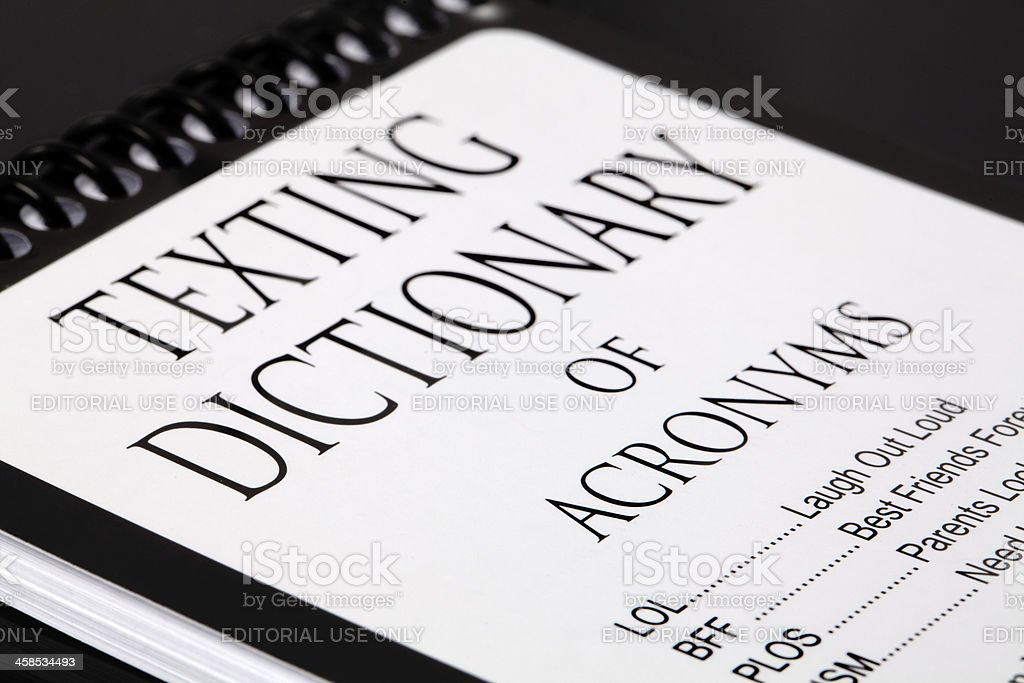 Texting Dictionary of Acronyms stock photo