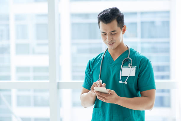 Texting doctor stock photo