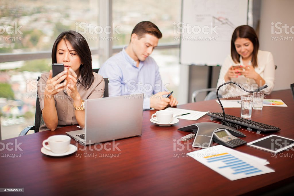Texting during work hours stock photo
