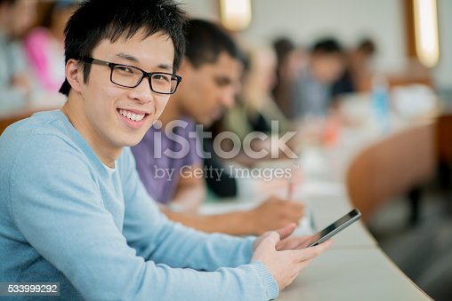 143071438 istock photo Texting in Class 533999292