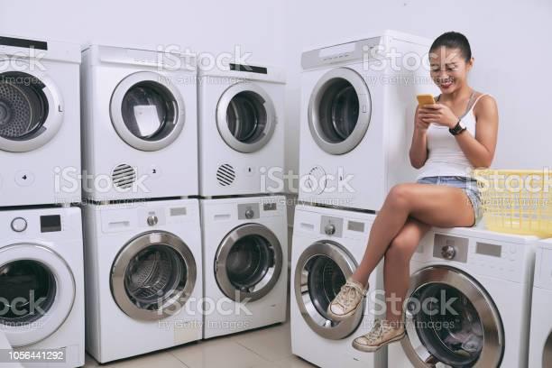Texting in laundry room picture id1056441292?b=1&k=6&m=1056441292&s=612x612&h=xyc0qyhml4kssz4yuzxcziezir9xowgpgefeuavdle4=