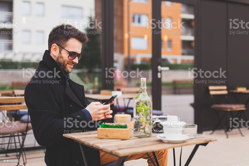 Texting in the cafe stock photo
