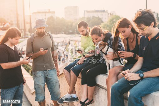 istock Texting in the city 636690578