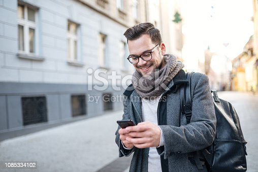 Texting in the city street.