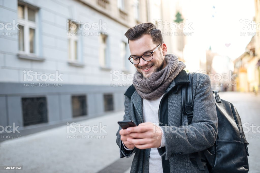 Texting in the city street. stock photo