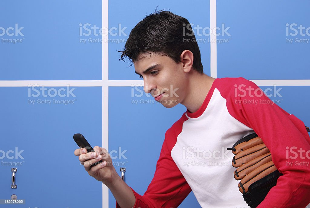 Texting In The Locker Room stock photo