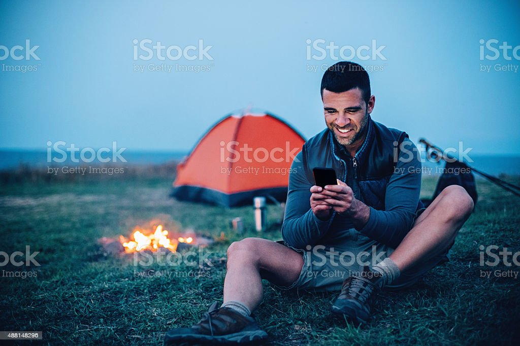 Texting in the mountain stock photo