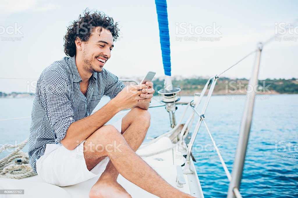 Texting in the sea - foto stock