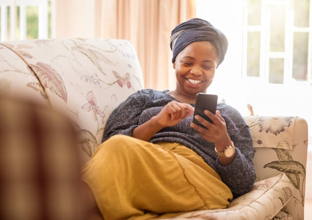 Texting is her best pastime stock photo