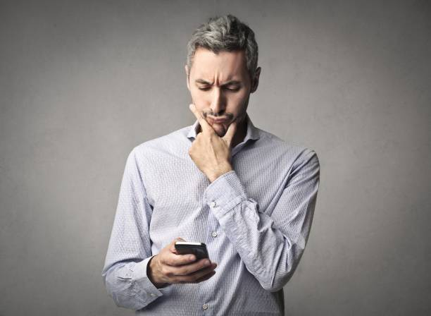 Texting man stock photo