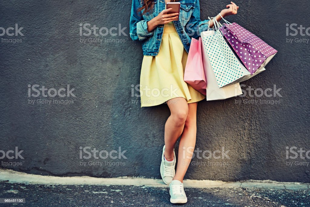 Texting my friends to join me on my shopping spree royalty-free stock photo