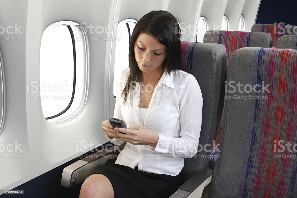 Texting On Airplane royalty-free stock photo
