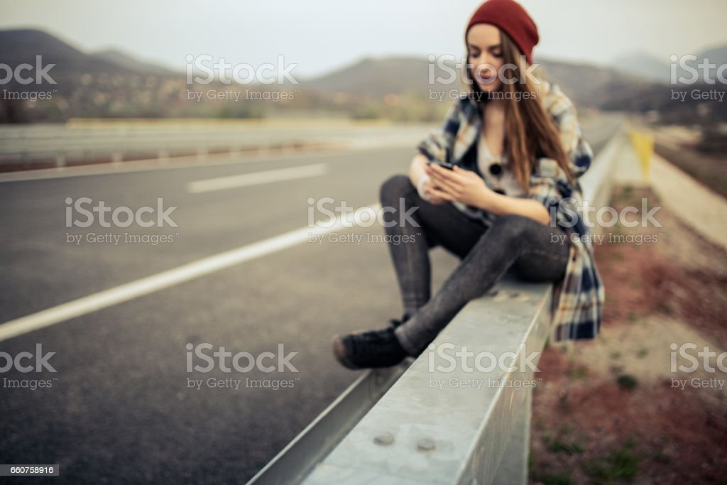 Texting on an empty road stock photo