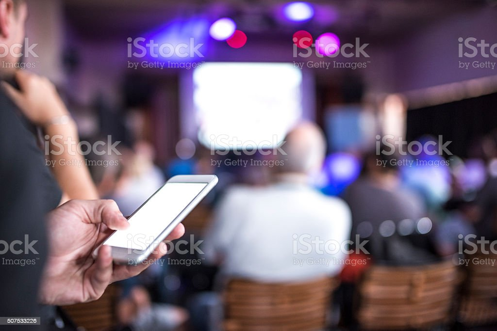 Texting on Business Seminar stock photo