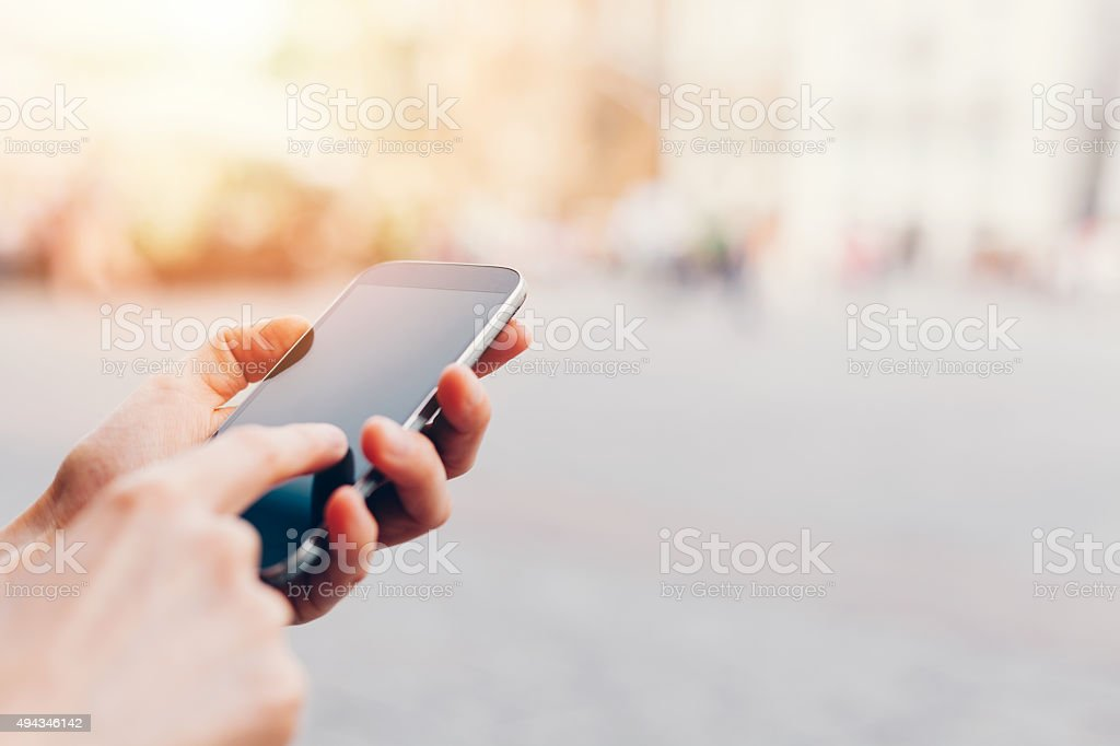 Texting on smartphone stock photo