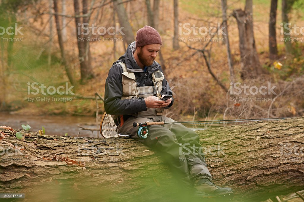 Texting one of his mates stock photo