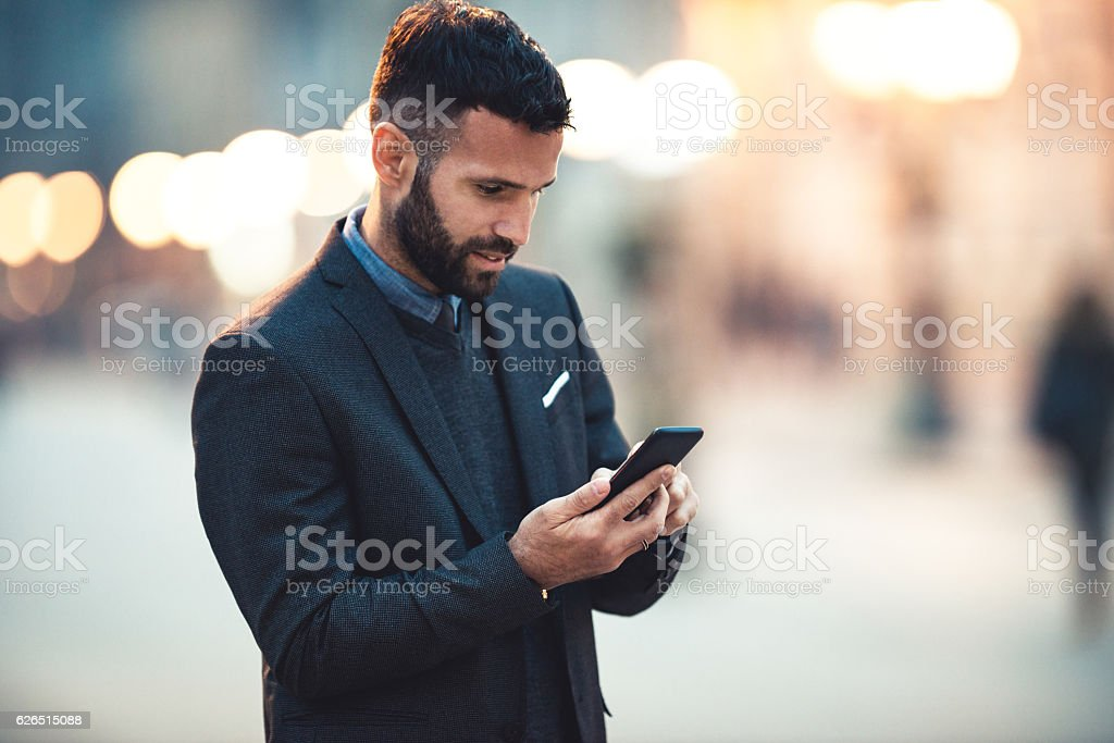 Texting outdoors stock photo