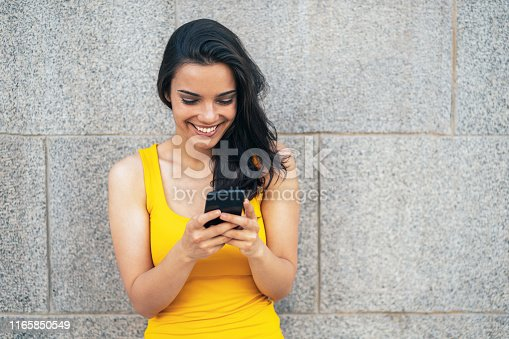 Young beautiful woman with smartphone outdoor