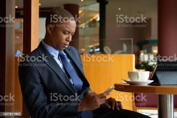 Texting Serious Entrepreneur Stock Photo - Download Image Now
