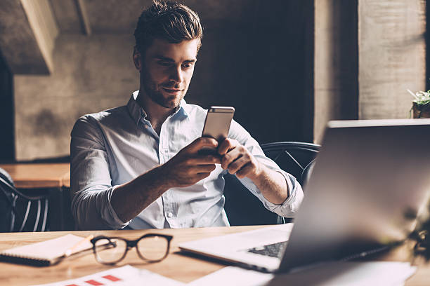 Texting to colleague. stock photo