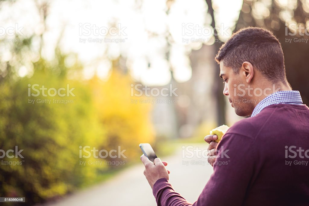 Texting to friends stock photo