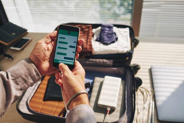 Texting traveler stock photo