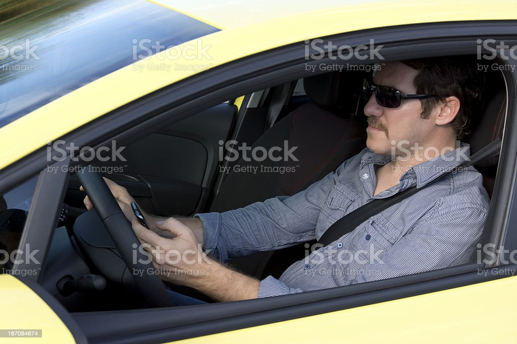 Texting while driving royalty-free stock photo