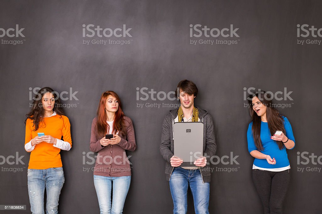 Texting with a huge smart phone stock photo