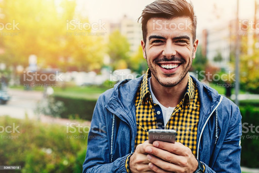 Texting with smile to friends stock photo