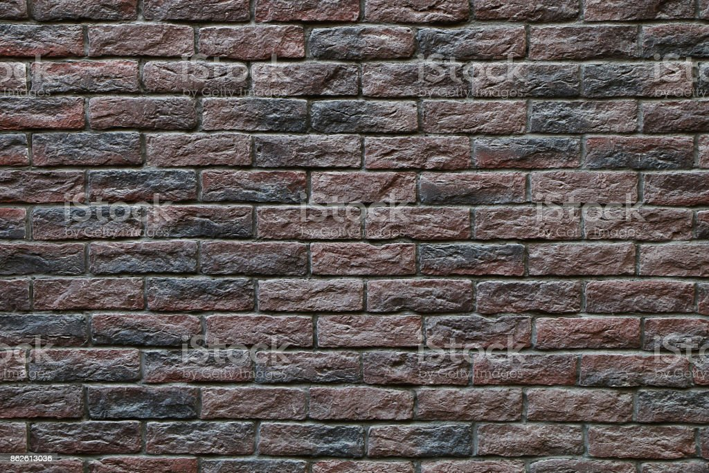 Texture - a fragment of a dark stone wall stock photo