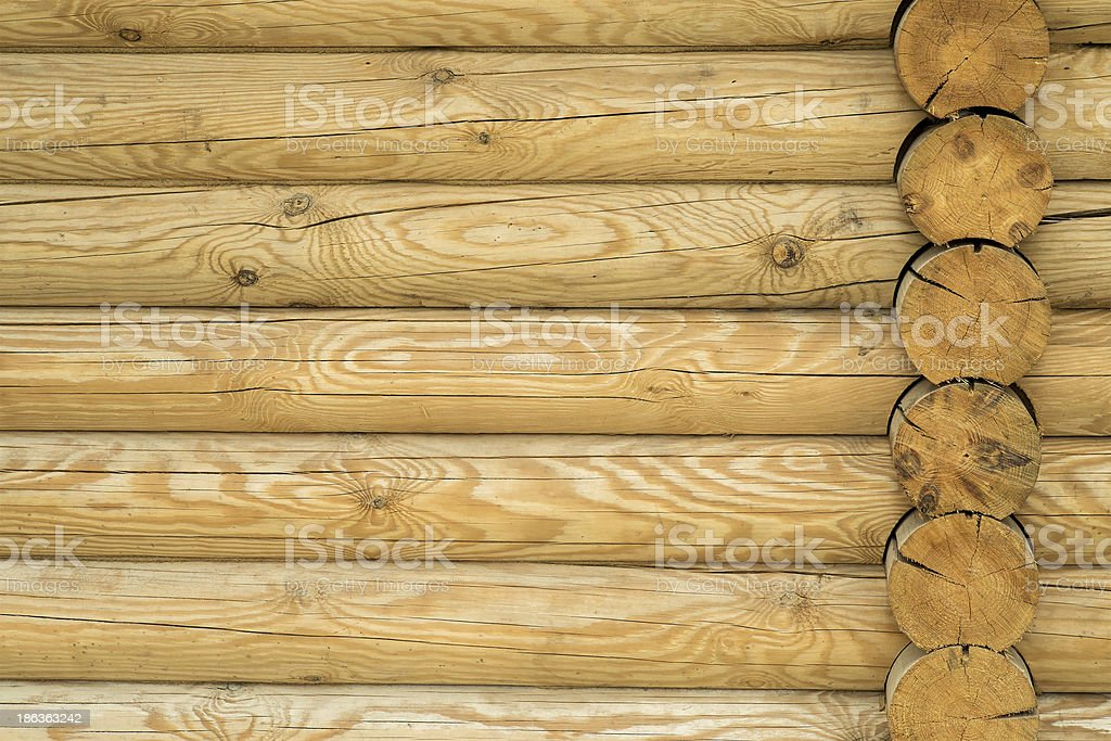 Texture, a wall made of wooden logs royalty-free stock photo