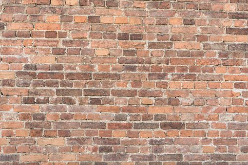 Texture ancient brick wall, horizontal arrangement of old brickwork, abstract background