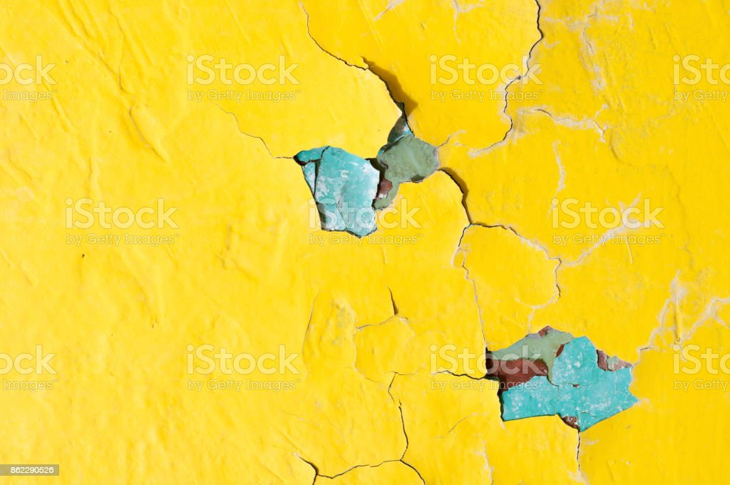 Texture background of bright yellow and blue peeling paint stock photo