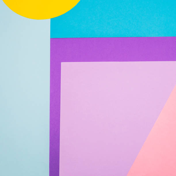Texture background of fashion blue, yellow and purple papers in memphis geometry style. Flat lay, 90s concept stock photo