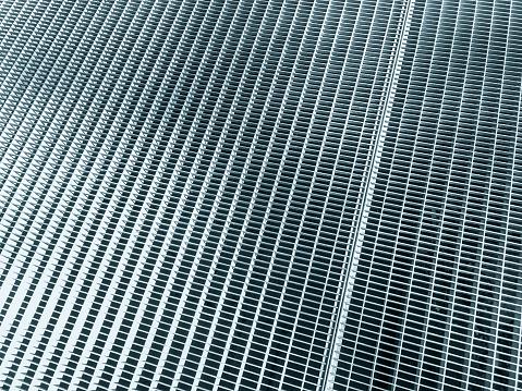 texture background of metal grid. stainless steel mesh. sidewalk subway grate or ventilation grid