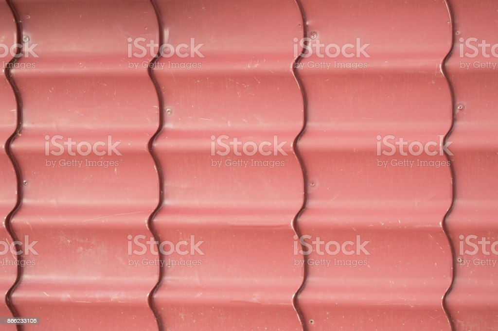 Texture background of red metal siding to finish the outside stock photo