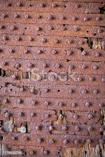 Texture background on ancient Ottoman wooden door  with metallic pins in Sigri,Lesvos