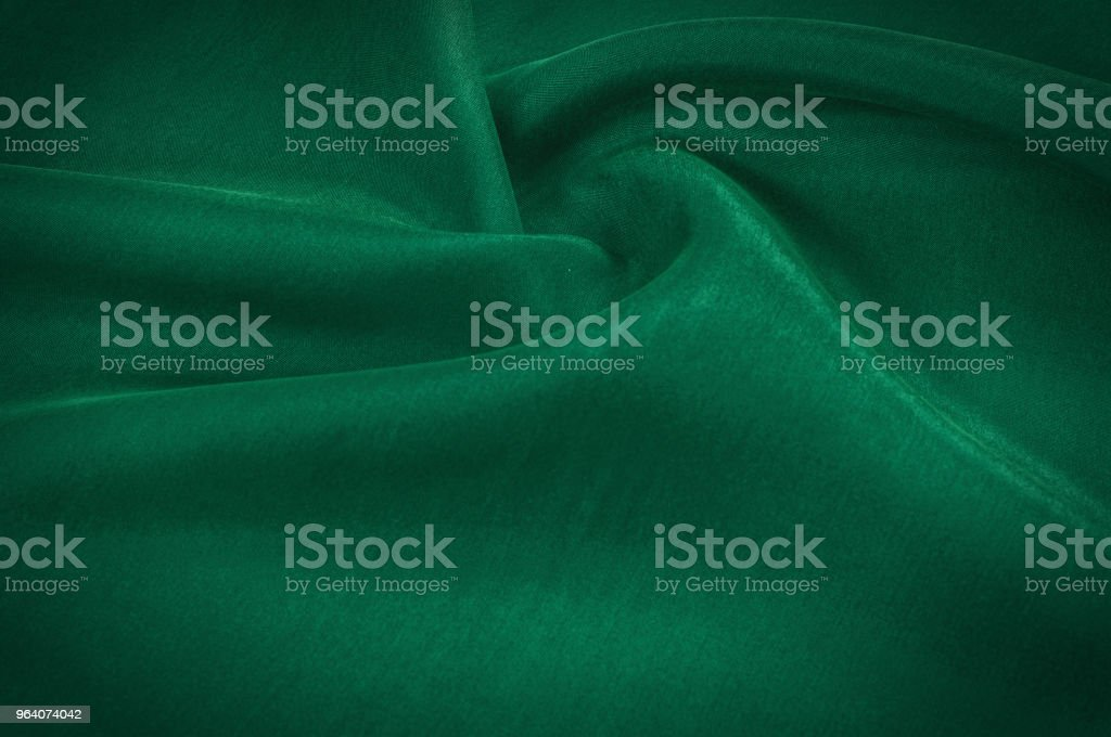 Texture background pattern. Abstract background of luxurious green fabric or liquid waves or wavy folds of a grunge silk texture of a satin velvet material or a luxurious background or elegant wallpaper - Royalty-free Abstract Stock Photo