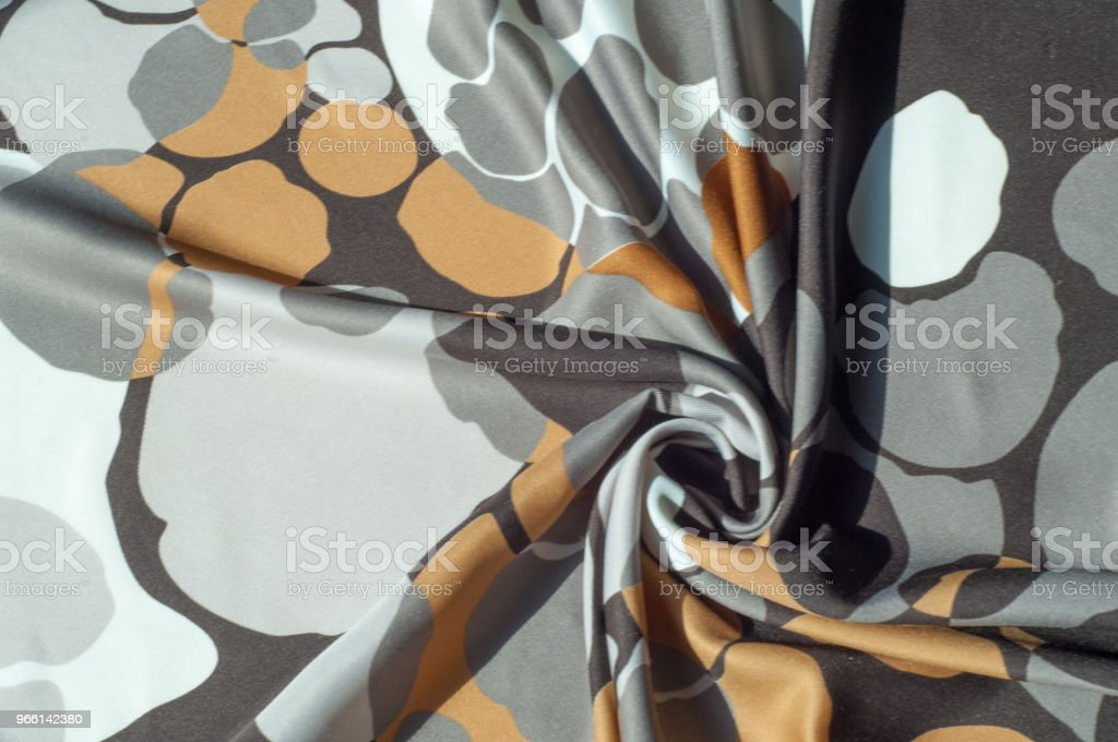 Texture, background, pattern. Abstract pattern on a silk fabric, white yellow brown circles - Royalty-free Abstrato Foto de stock