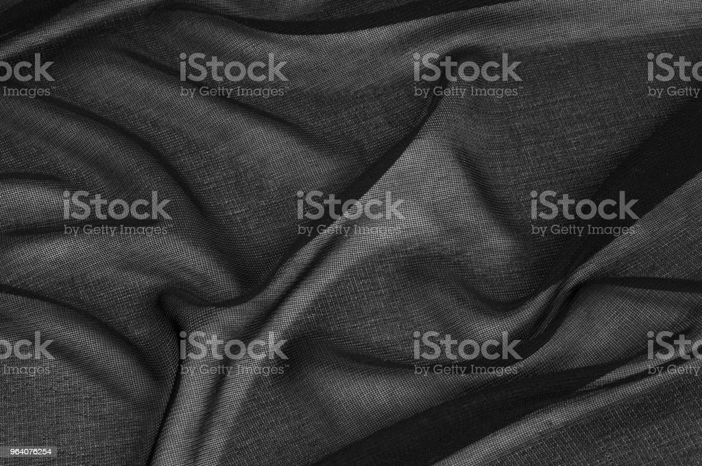 Texture, background, pattern. Black transparent fabric. Black Mesh Fabric See Through Sheer Stretchy Goth Punk Scene Emo Trendy Sexy Fashion Transparent Cover Up Four way stretch - Royalty-free Abstract Stock Photo