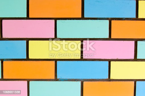 istock Texture background, pattern. Bricks painted with paint 1068651338
